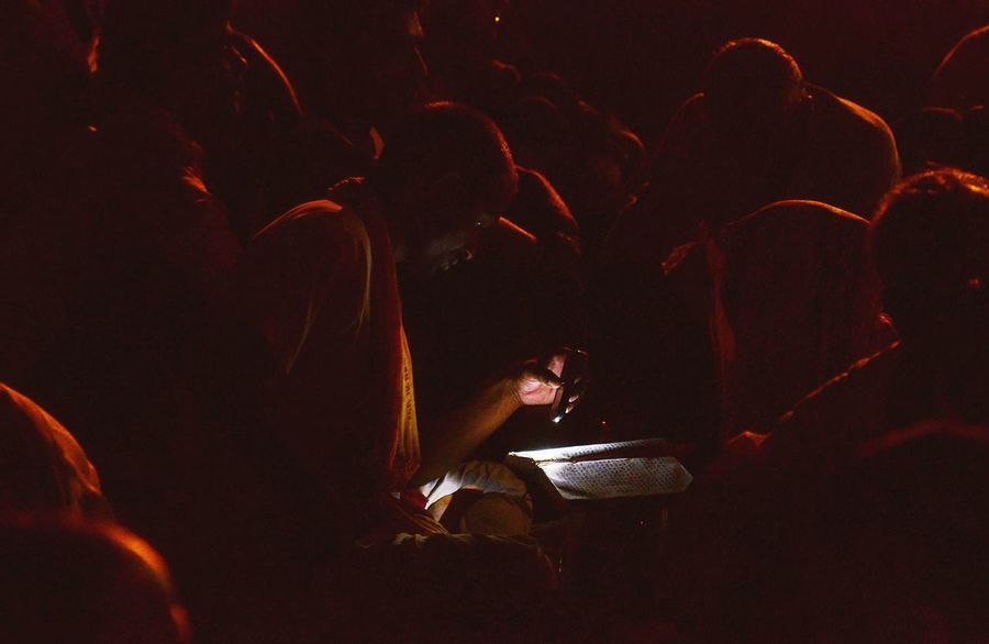 "An indian #hindu devotee reads #holy book #ramcharitmanas , in torch light , during the historical ""Ram Nagar ki Ram Leela"" in #ramnagar , #varanasi . #varanasidiaries #varanasiindia #india Real People Arts Culture And Entertainment Night Audience People Photojournalism Photojournalist Ganges River Paint The Town Yellow India ASIA Varanasi, India Ganges, Indian Lifestyle And Culture, Bathing In The Ganges, Varanasi Varanasidiaries RamLeela"