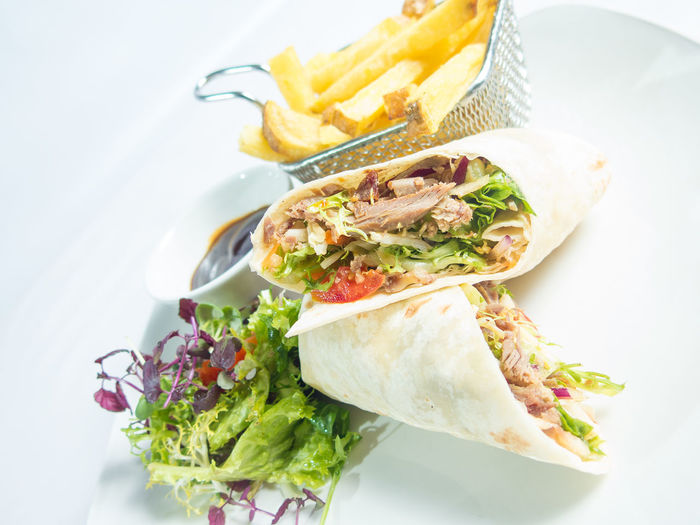Close-Up Of Wrap Sandwich Served In Plate
