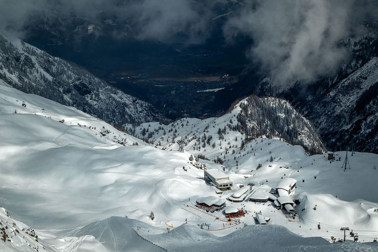 Beautiful environment and view from above to ski resort. scenic view of snow covered mountains.