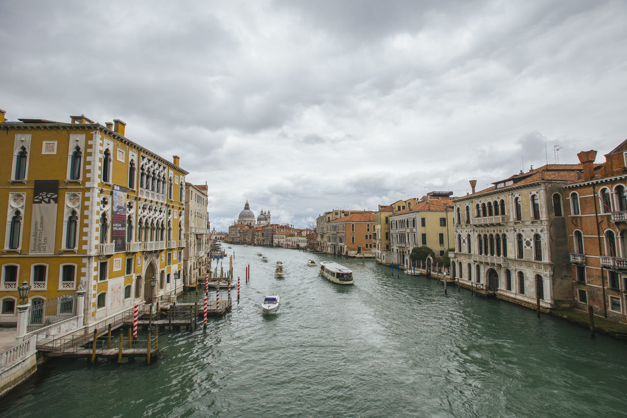 architecture, building exterior, built structure, canal, cloud - sky, water, sky, nautical vessel, day, waterfront, outdoors, transportation, residential building, no people, travel destinations, city, gondola - traditional boat