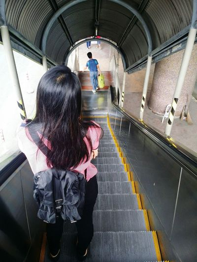 Rear view of woman in subway station