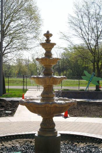 Fountain in park against sky
