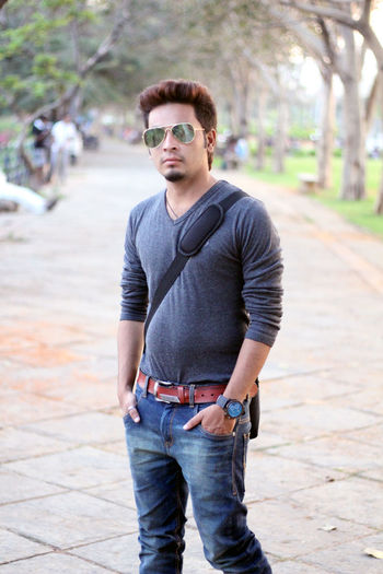 EyeEm Selects Sunglasses One Man Only Casual Clothing Only Men Jeans One Person One Young Man Only Fashion Adults Only Adult Standing Hands In Pockets Young Adult People Cool Attitude Young Men Arts Culture And Entertainment Men Portrait Outdoors