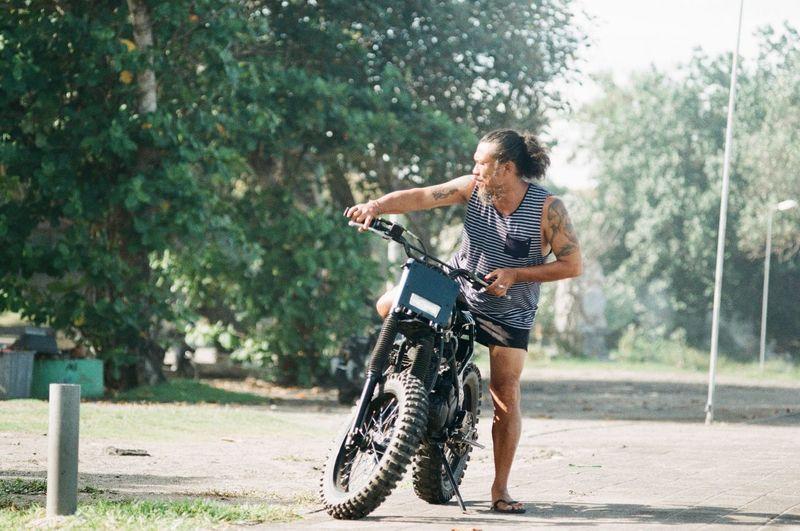 Full length of man riding motorbike