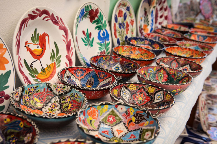 Greek pottery with folk patterns Art And Craft Multi Colored Indoors  Creativity Pattern Table Still Life Close-up Craft Floral Pattern Large Group Of Objects Plate Design No People Bowl Ceramics Abundance Arrangement Choice Focus On Foreground Pottery