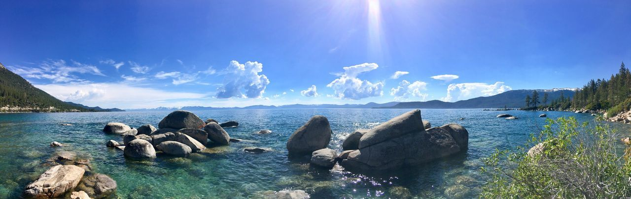 Panoramic view of sea against blue sky