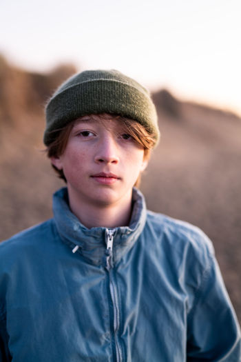 Portrait of young man wearing hat