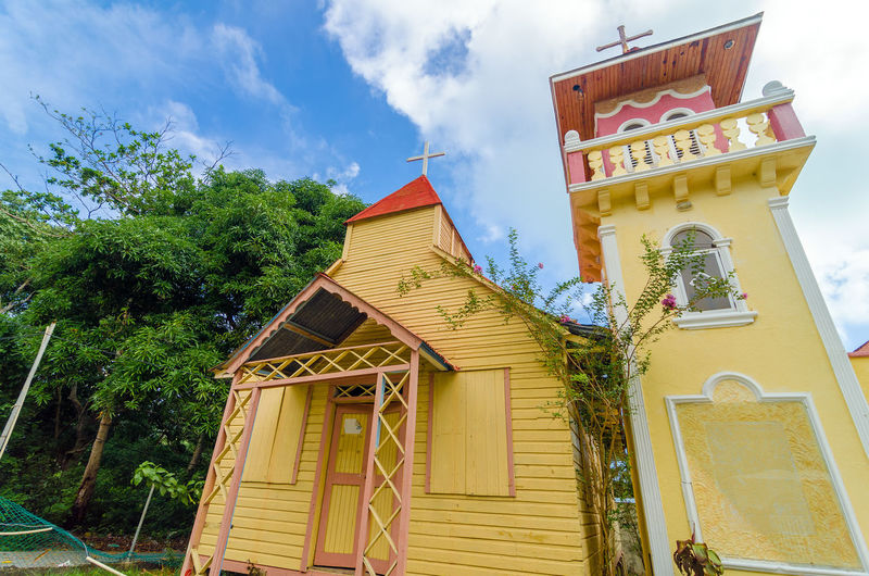 Yellow and pink church on the Caribbean island of San Andres y Providencia, Colombia Architecture Baptist Building Caribbean Cathedral Center Chirstian Christianity Church Colombia Colorful Community Congregation Exterior Faith Façade Front God Hall Landmark Outdoors Providencia SanAndres Tourism Worship