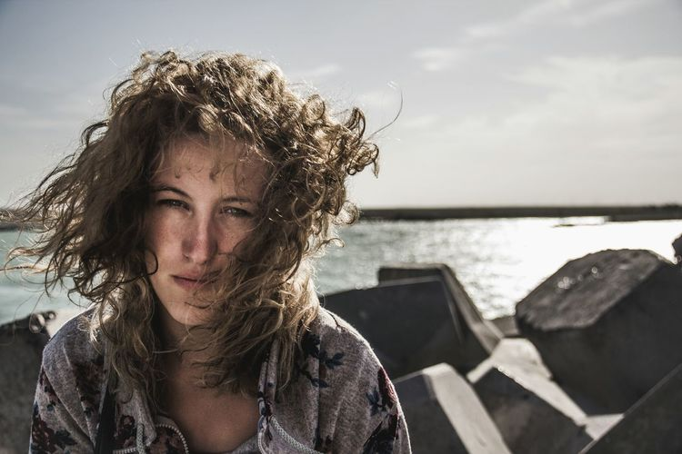 Portrait Of Young Woman During Windy Weather At Beach