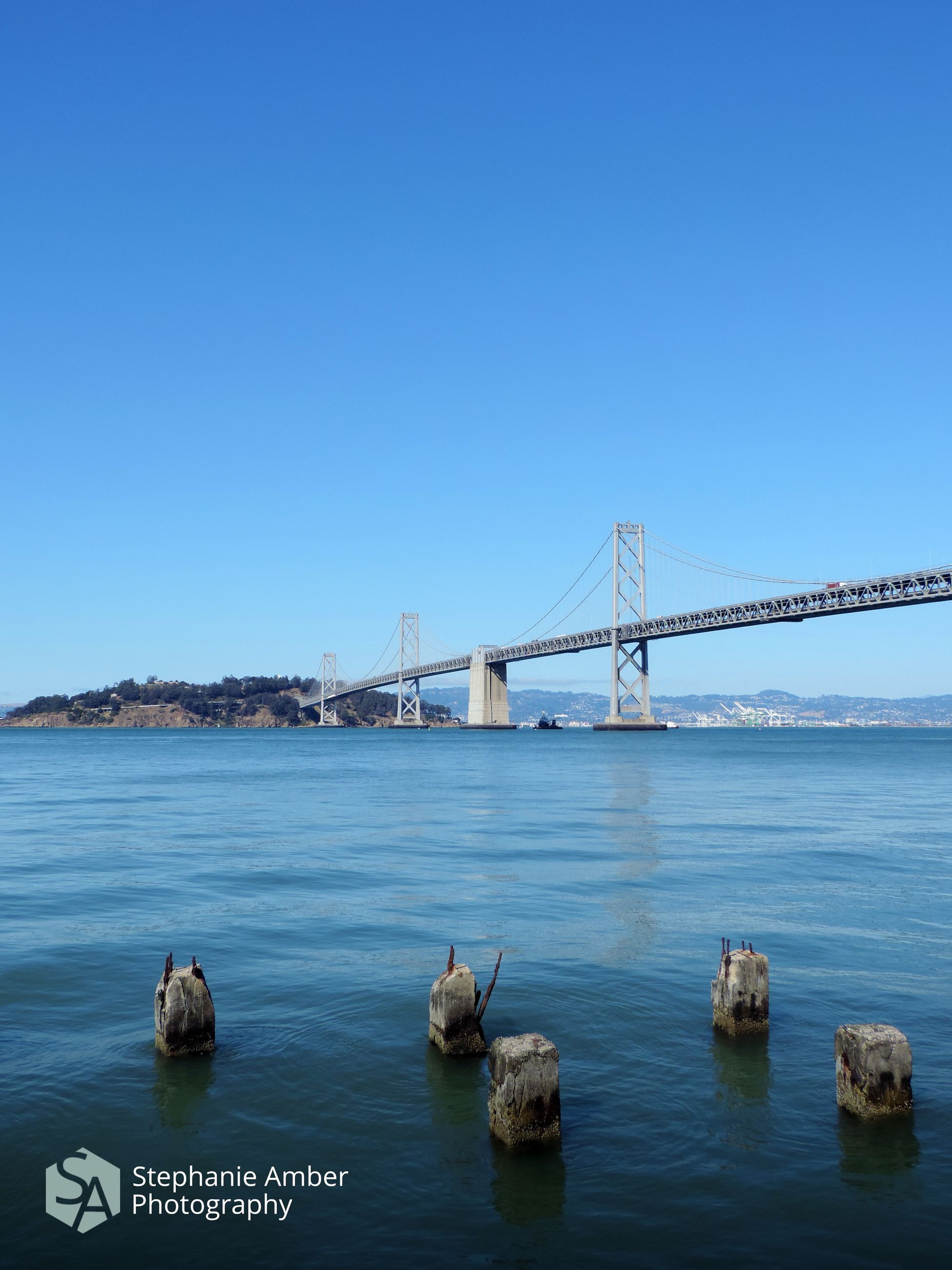 water, bridge, sky, bridge - man made structure, connection, built structure, transportation, clear sky, architecture, nature, sea, copy space, blue, suspension bridge, day, waterfront, no people, beauty in nature, travel destinations, bay