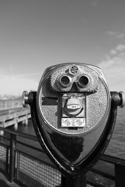 Tower viewer binoculars on Liberty Island looking towards Manhattan, New York. Pier and Manhattan skyline in the distance. Black and white, focus on tower viewer. Architecture Binoculars Cityscape Close-up Coin Operated Coin-operated Binoculars Ellis Island  Hudson River Hudson River Ny Liberty Island Manhattan Manhattan New York Manhattan Skyline Manhattan, New York City New York City New York City Photos New York Harbor New York Skyline  New York ❤ New York, New York No People Sightseeing Statue Of Liberty Statue Of Liberty New York Tower Viewer