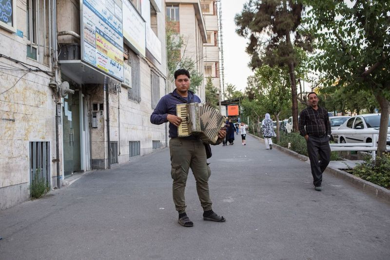 He is mucican, i see him everyday at tehranpars he play and bag for money,he play accordion all the time And sing something to make people happy. Tehran, Iran Mix Yourself A Good Time EyeEmNewHere The Street Photographer - 2018 EyeEm Awards A New Beginning The Art Of Street Photography The Street Photographer - 2019 EyeEm Awards