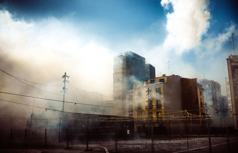 Mascleta in Onda Apocalypse Explosion Mascleta Smoke Apocolyptic Architecture Building Exterior Built Structure Cable City Cloud - Sky Day Electricity Pylon Mist Nature No People Outdoors Pollution Sky EyeEmNewHere
