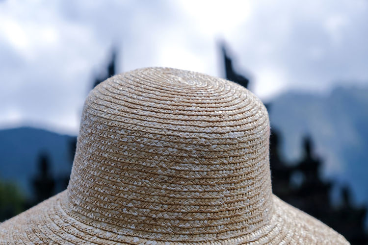 Rear view of person wearing hat