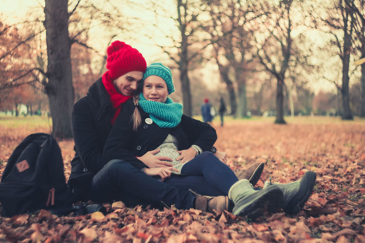 Portrait of couple sitting in park