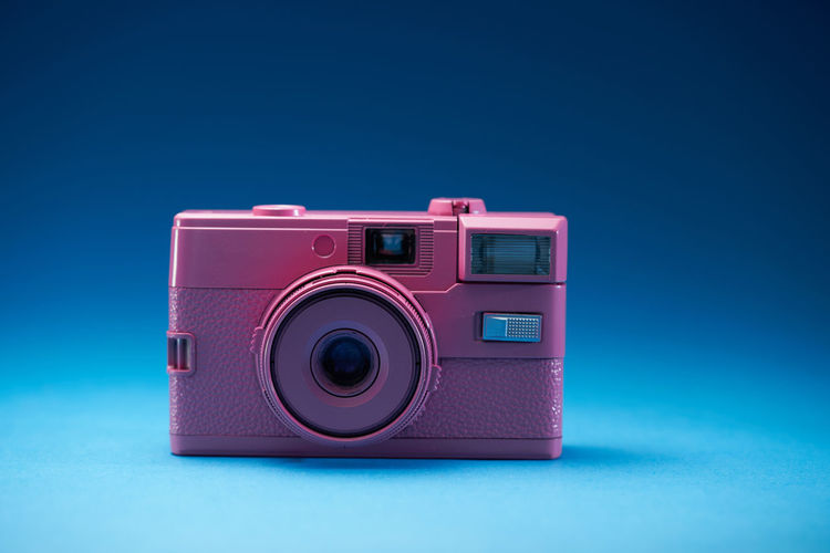 Close-up of camera against blue background