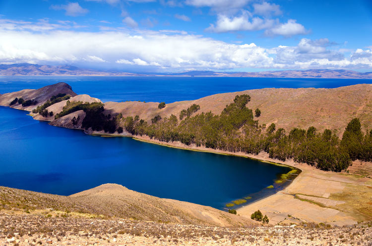 Beautiful view of the Island of the Sun on Lake Titicaca in Bolivia Adventure Agriculture Altitude Andean Beach Bolivia Coast Copacabana Countryside Destination Ethnic Farm Hill Inca Isla Island Lake Landscape Mountain Peru Scene Sol SunIsland Titicaca Tourism