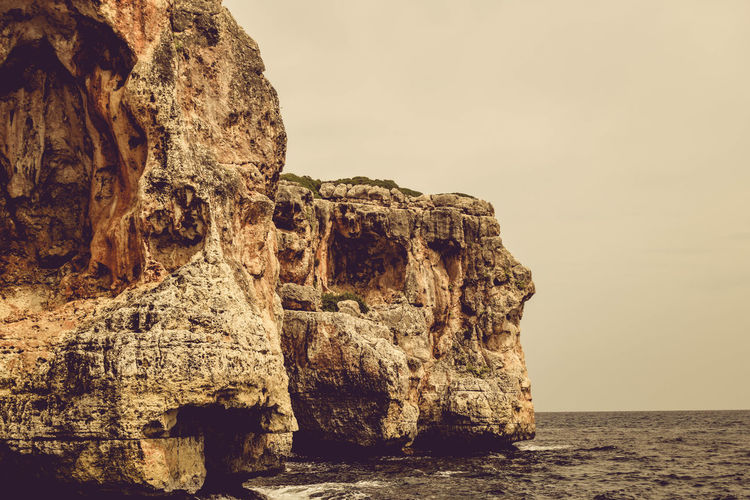 Rock Sea Rock Formation Rock - Object Sky Tranquility Water Solid Scenics - Nature Tranquil Scene Nature No People Beauty In Nature Cliff Geology Land Waterfront Non-urban Scene Horizon Over Water Outdoors Eroded Stack Rock Formation