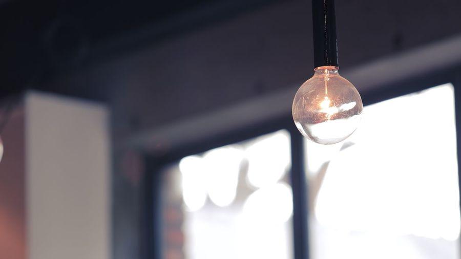 Close-up of illuminated electric bulb