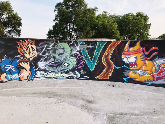 Graffiti Art And Craft Creativity Day Multi Colored Street Art Tree No People Representation Plant Sky Nature Outdoors Human Representation Architecture Wall - Building Feature Built Structure City Wall Mural
