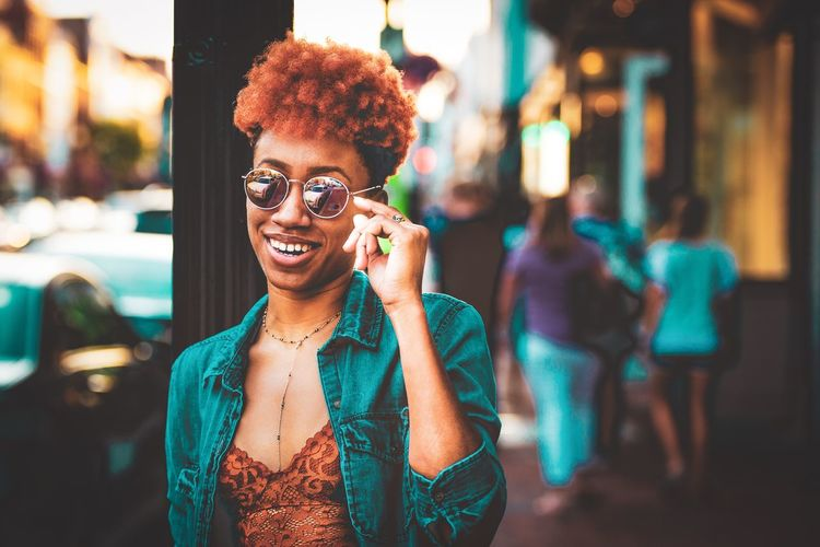 Happiness begins with one's self! Bestlife  Carefree Confident  Jeans Woman Streetphotography Vibrant Color Orange Hair Glasses Vsoulphotos EyeEm Selects Portrait Happiness One Person Smiling Lifestyles Young Adult