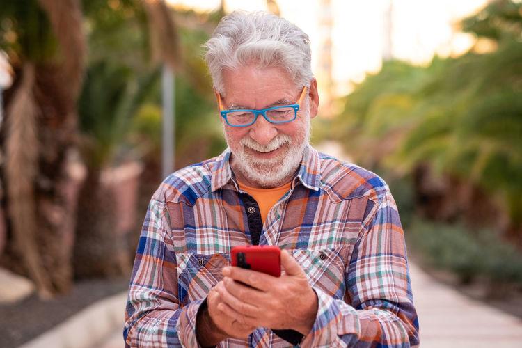 Portrait of man using smart phone outdoors