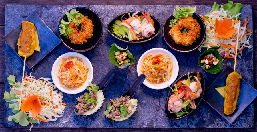 Variation diffrent popular thai foods on a stone plate Appetizer Choice Day Food Food And Drink Freshness Healthy Eating High Angle View Indoors  No People Plate Prawn Ready-to-eat Seafood Thai Food Thailand Food Top View Variation