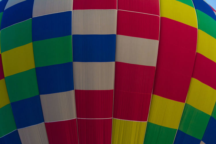 The colored pattern or texture of hot air balloon Colors Red Textured  Transport Vivid Air Air Vehicle Background Backgrounds Balloon Ballooning Festival Blue Close-up Competition Cup Design Geometric Shape Hot Air Balloon Multi Colored Pattern Repetition Shape Sport White Color Yellow