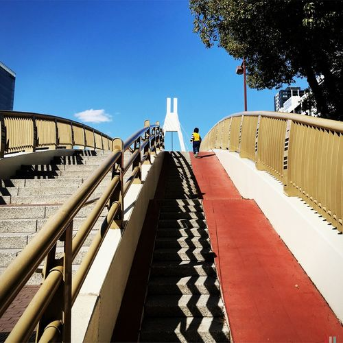 Architecture Bridge Stairs Staircase Building Blue The Way Forward Low Angle View Diminishing Perspective Day City City Life Cityscapes Vanishing Point Walkway Sky Sunny Holiday Kids Family Full Length Tree Fine Art Photography Colour Of Life Adapted To The City Long Goodbye