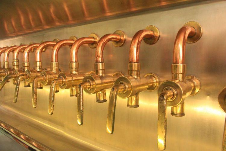 Close-up of beer taps at bar