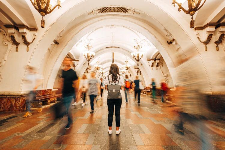 Group of people walking in corridor of building