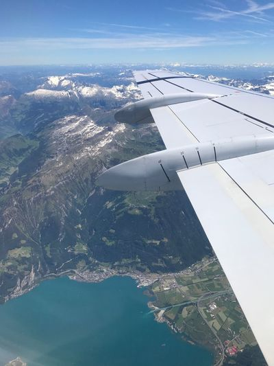 Aerial View Airplane Water Nature Transportation Airplane Wing Beauty In Nature Day Mid-air Journey Scenics No People Mode Of Transport Sea Outdoors Air Vehicle Sky Aircraft Wing Tranquil Scene Tranquility Swissalps Been There. The Week On EyeEm Connected By Travel