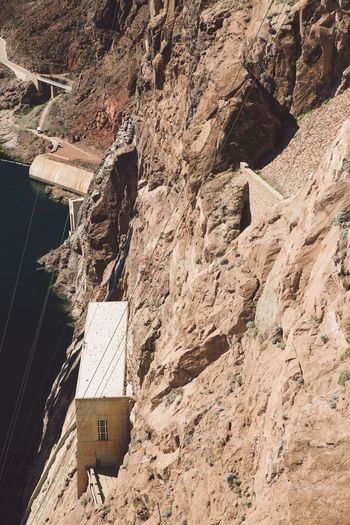 High angle view of building amidst rocky mountains at hoover dam