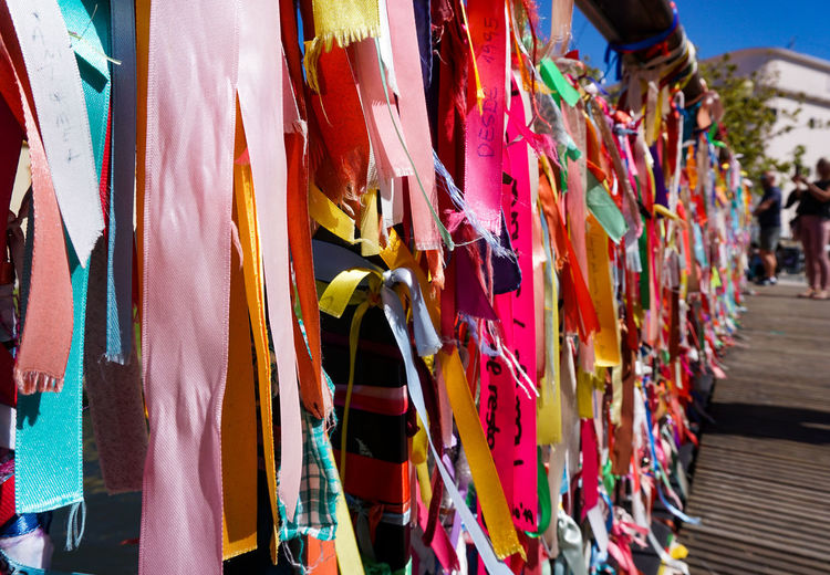 Multi colored ribbons hanging outdoors