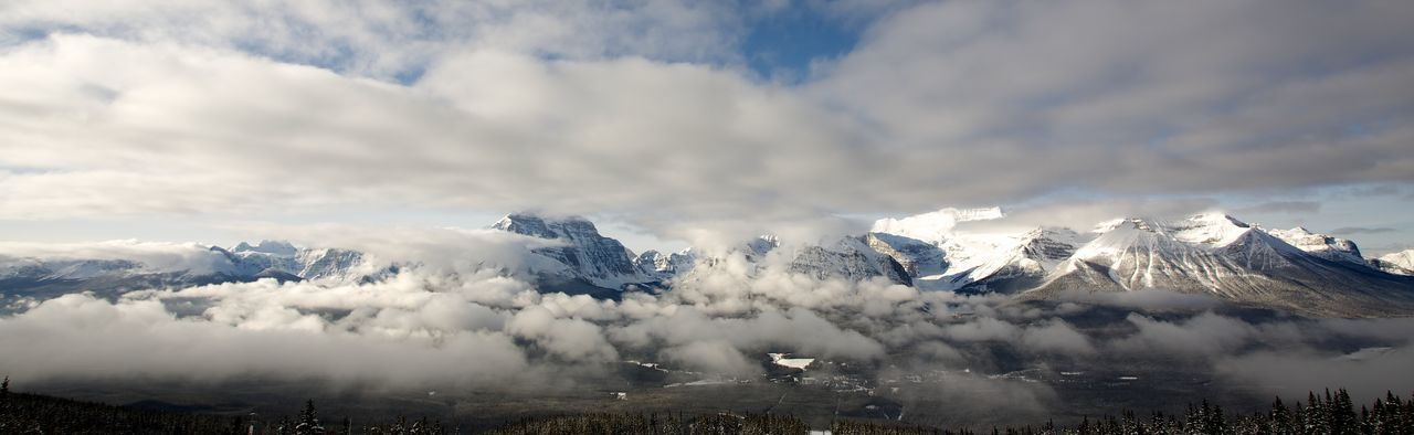 Panoramic view of mountains at banff national park against cloudy sky during winter