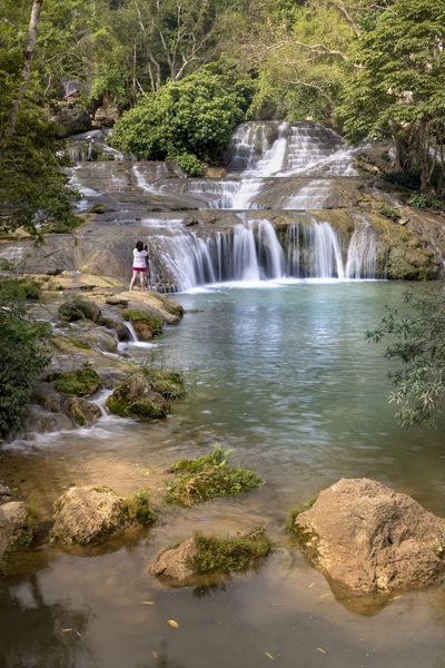 Dang Mo waterfall in Lang Son province, Vietnam Woman Beauty In Nature Blurred Motion Dangerous Environment Flowing Flowing Water Forest Land Long Exposure Motion Nature Outdoors Photographer Plant Power In Nature Power Water Rainforest Rock Rock - Object Scenics - Nature Tree Tropical Water Waterfall