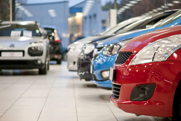 Used cars in various colors standing in a showroom ready for sale Cars Sale Second Hand Used Cars Buying Car Car Center Car Dealer Car Dealer Shop Close-up Deal Focus On Foreground For Sale In A Row Land Vehicle No People Red Road Sales Sell Selling Showroom Cars Stationary Transportation Used