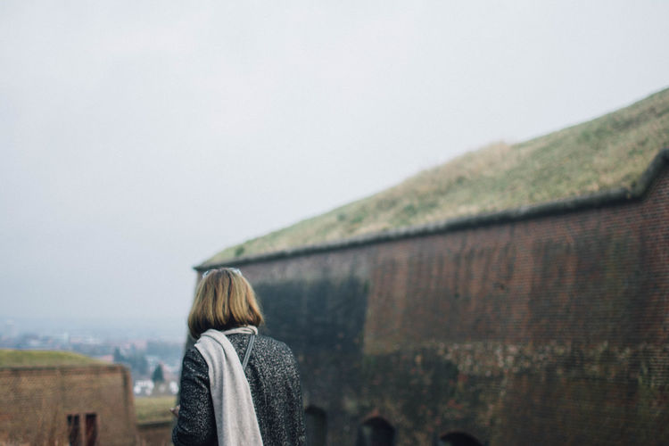 A Day In Nature Blond Hair Cashmere Scarf City From Above Cold Day Copy Space Day Focus On Foreground Leisure Activity Lifestyles Mother Nature Nature Old Castle Old Ruin One Person One Woman Only Outdoors Rainy Season Sky Standing Warm Clothing Winter Clothing Women