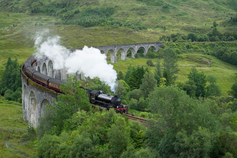 High Angle View Of Steam Train On Bridge