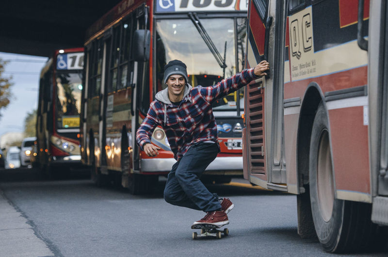 Skateboarding Action Casual Clothing Front View Happiness Land Vehicle Lifestyles Men Mode Of Transportation Motor Vehicle One Person Outdoors Portrait Real People Smiling Transportation Young Adult Young Men