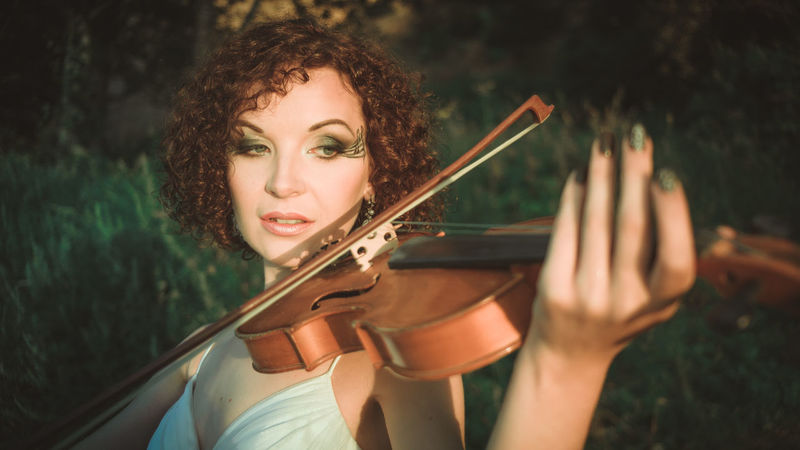 Adult Adults Only Classical Concert Close-up Curly Hair Day Holding Human Body Part Music Musical Instrument Musician One Person One Woman Only One Young Woman Only Only Women Outdoors People Playing Portrait Violin Violinist Women Young Adult Young Women