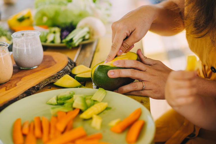 Midsection of woman preparing food at home