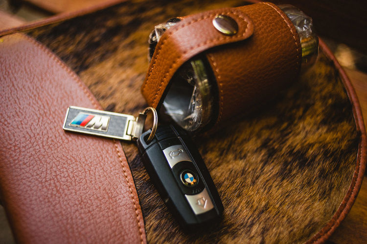 Close-up Leather No People Brown Indoors  Fashion Security Still Life Personal Accessory Bag Protection Safety Table Single Object Technology Equipment Focus On Foreground Photography Themes Metal Zipper Menswear EyeEm Selects Bmw M3