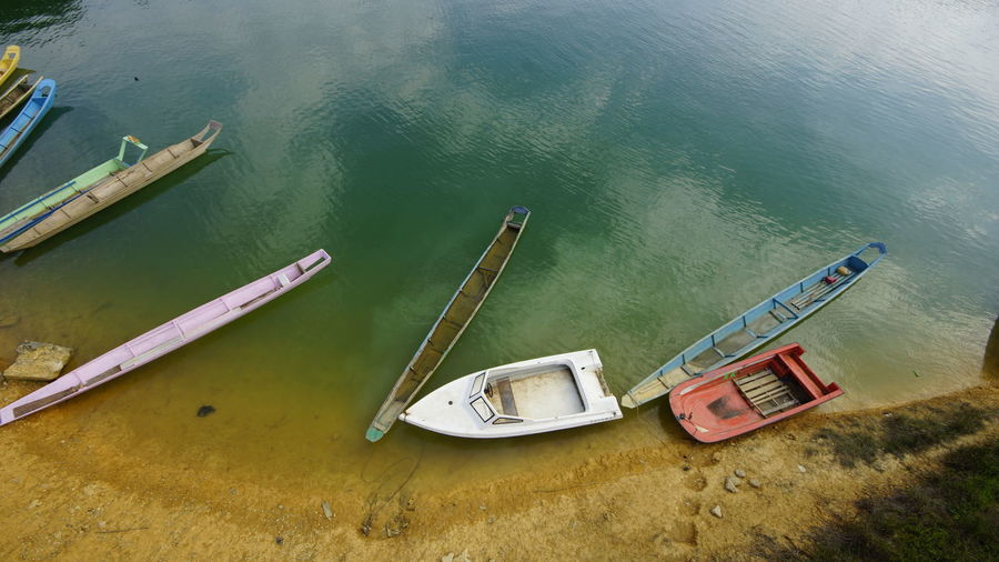 High angle view of fishing boats moored in sea