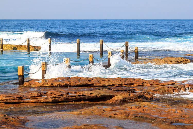 Waves crashing into the Mahon rock pool Swimming Beach Beauty In Nature Day Horizon Over Water Mahon Pool Motion Nature No People Outdoors Pool Rock Pools Scenics Sea Sky Swimming Pool Travel Destinations Water Wave