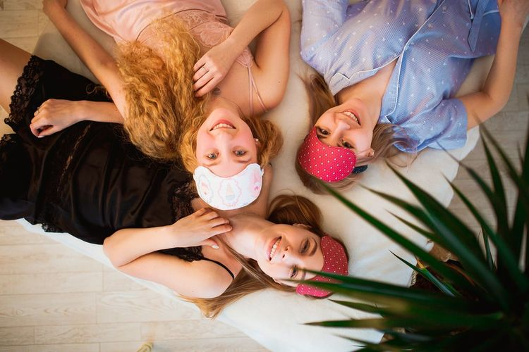 Brides Child Lying Down Mother Daughter Girls Females Family Adult Togetherness Childhood Indoors  Family With Two Children Baby People High Angle View Lifestyles Family With One Child Domestic Life Relaxation Bed