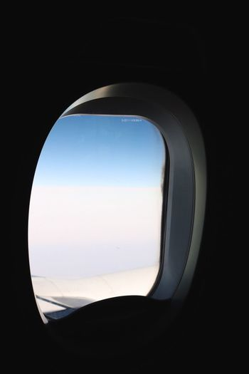 Traveling Home For The Holidays Window Transportation Clear Sky Journey Airplane Indoors  No People Day Sky Plane Air Airplane Wing Close-up ELLIPSE Welcome To Black