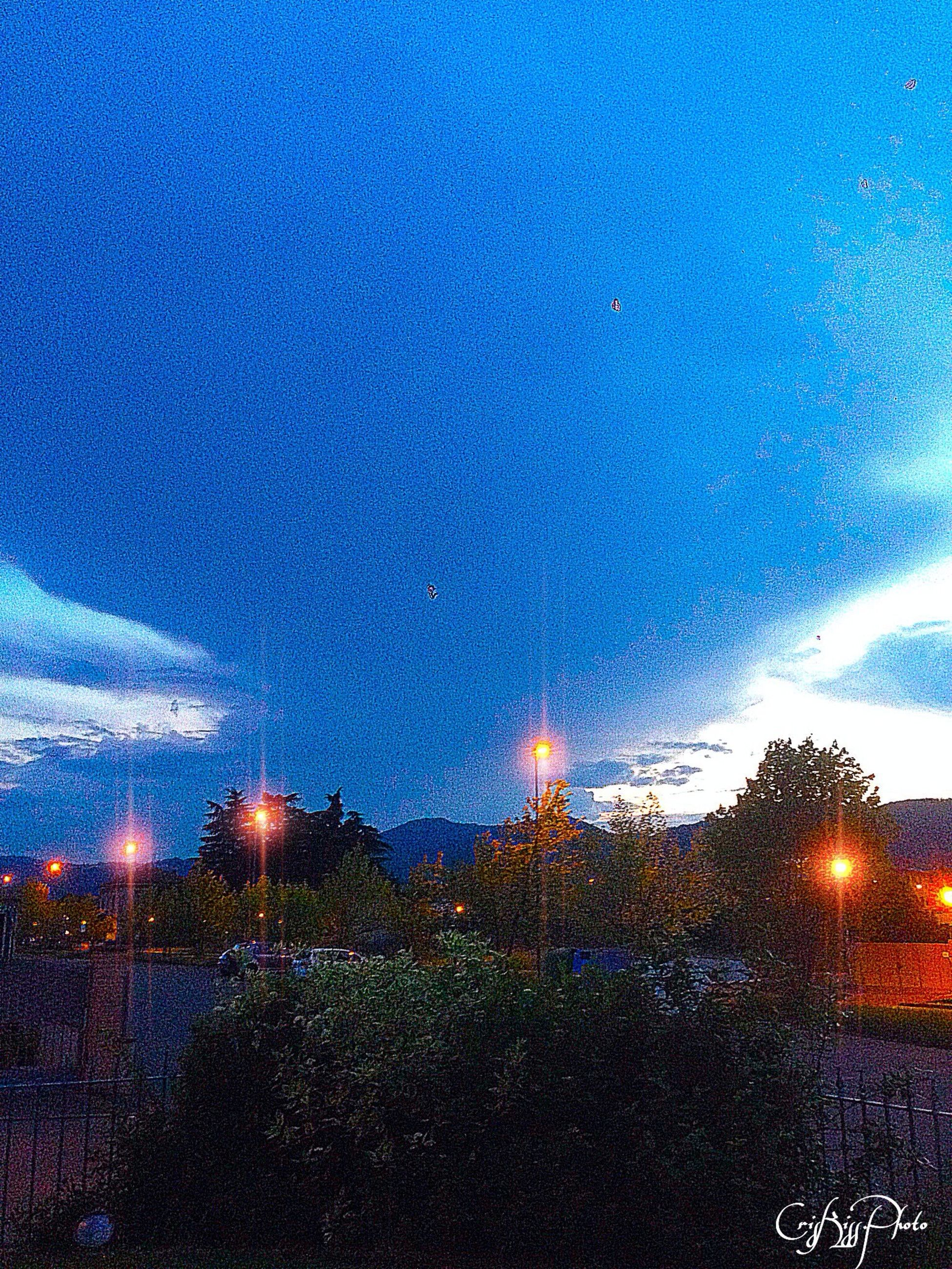 illuminated, window, sky, night, glass - material, transparent, wet, drop, blue, season, weather, dusk, building exterior, rain, city, full frame, water, sunset, no people, backgrounds