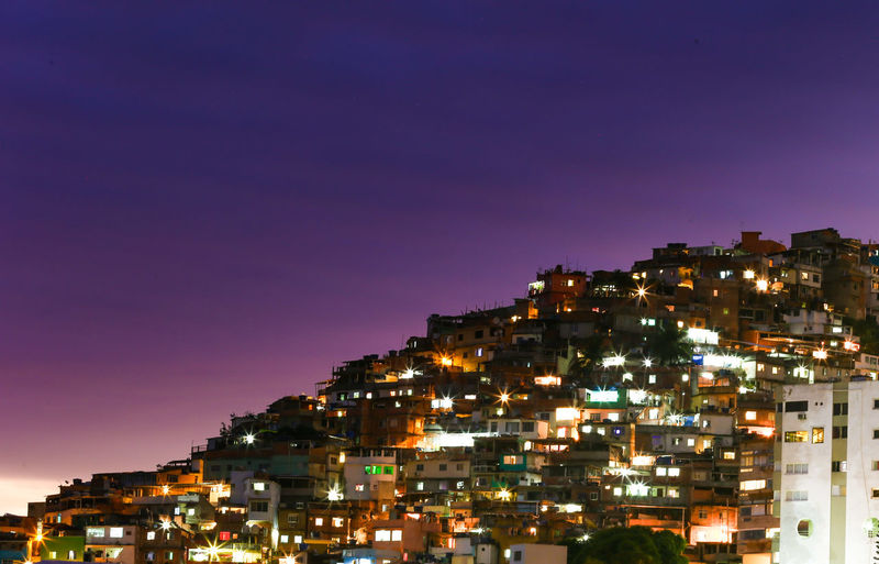 When the sun sets over the Favela in Rio de Janeiro Brazil. Brasil ♥ Brasilien Brazil Himmel Houses Rio Rio De Janeiro Brasil Brazilian Gallery Built Structure City Cityscape Favela Favelabrazil Favelas House Lights In The Dark Night No People Outdoors Sky Streetphotography Sunset
