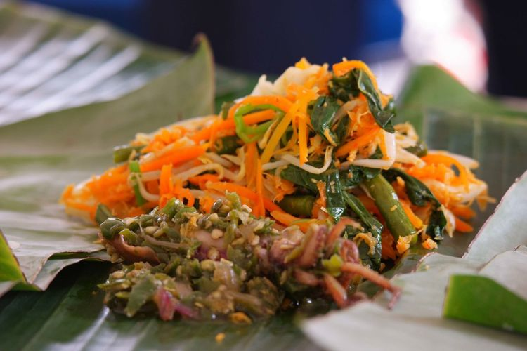 Close-up of vegetables with shredded coconut in plate